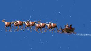 animated santa animated santa claus with sleigh in snowfall blue black screen