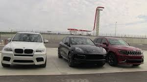 bmw jeep 2014 jeep grand cherokee srt vs bmw x5 m vs porsche cayenne gts 0