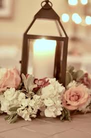 lantern with flowers centerpieces u2014 southern productions