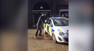 for kids police vs car thug caught on camera smashing up police car while officers pay