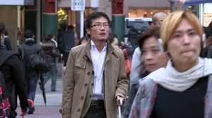 Tokyo Japan Circa November 2016 Crowds Of People Walking In Tokyo by Tokyo Japan Circa November 2016 Japanese Woman Walking In Slow