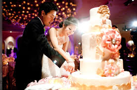 wedding cake cutting and groom cut wedding cake
