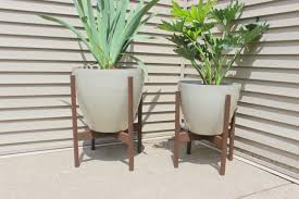 Planters On Wheels by Plant Stand Indoorlanter On Wooden Stand Stands Wheels Oval