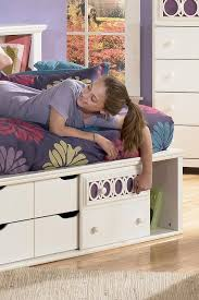 signature design by ashley zoey twin storage daybed rotmans