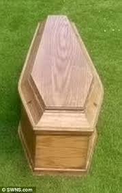 coffin for sale casket with a few scratches put up for sale at bargain price of