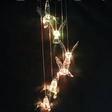 solar powered wind chime light image solar powered led changing light color hummingbird wind