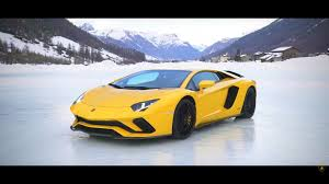 lexus dance of f watch a snowbound lamborghini aventador s dance with an airplane