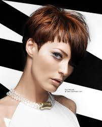short hairstyle with an asymmetrical fringe and blunt side burns
