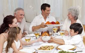 Family At Thanksgiving Dinner Family Having A Big Dinner At Home Stock Photo Picture And