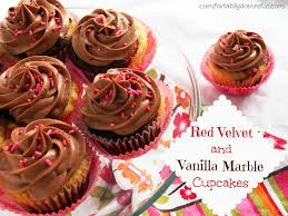 red velvet vanilla marble cupcakes with milk chocolate buttercream