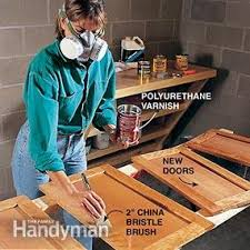 How To Hang Kitchen Cabinet Doors How To Refinish Kitchen Cabinets Family Handyman