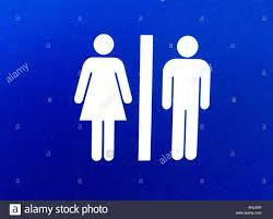 men women bathroom toilet door sign stock photo royalty free