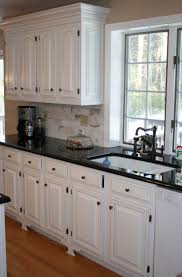 kitchen with white cabinets and dark countertops home design ideas