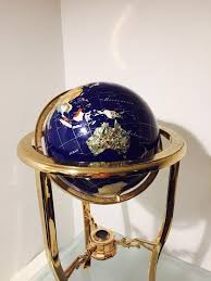 handmade multi textured ornamental globe with compass stand in