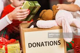 family donating gifts and toys to charity for