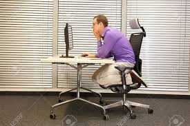 Ergonomic Chair And Desk Text Neck Man In Slouching Position Kneeling On Ergonomic Chair
