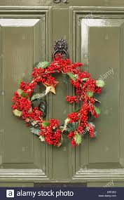 green front door of traditional english georgian house christmas