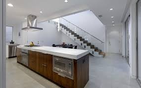 cost of subway tile backsplash kitchen contemporary kitchen with red granite countertops and
