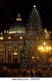 st peter u0027s basilica at night with christmas tree in rain italy