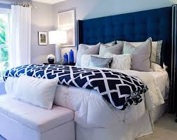 beautiful bedroom featuring tufted wingback headboard in blue