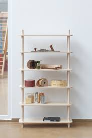 modular shelving system on wooden rods digsdigs