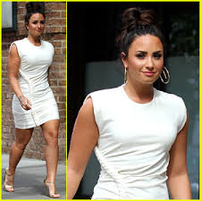 demi lovato wears a dress with a braid down the side demi lovato