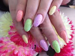 pastel polish with glitter over acrylic nails pretty painted