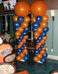 metallic silver and white balloon columns with a balloon flower