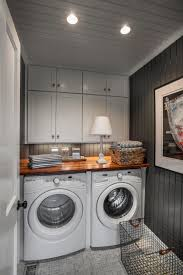 small laundry room with grey walls and built in cabinets design