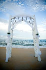 wedding arches decorated with tulle a sweet and simple white tulle arch with greens speaks siimplicity