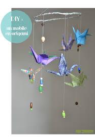 fabriquer déco chambre bébé diy fabriquer idée pour faire un mobile pour bébé avec des grues