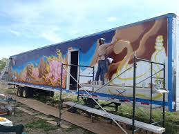 inspiration flaming pigs and the painting of a 53 foot mural on a as
