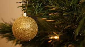 golden baubles decoration hanging in a tree