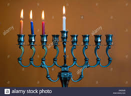 chanuka candles hanukkah menorah with four burning candles on the third day of