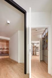 angled walls used to create blind spots in open plan apartment