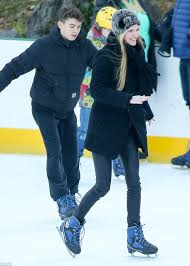 jude law struggles to ice skate with phillipa coan in central park