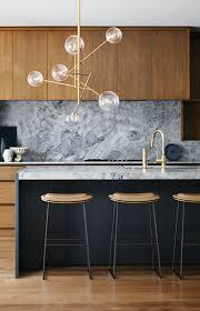 grey marble backsplash natural wood cabinets modern kitchen