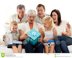 family opening presents in grandmother s birthday royalty free