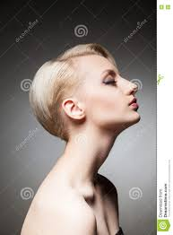 side view of pretty model with blonde short hair and eyes closed