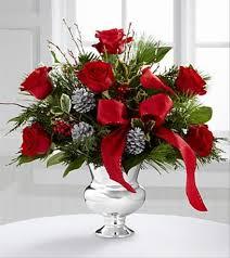 christmas floral arrangements christmas flower arrangement the florister