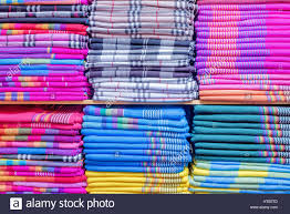 colorful clothes on the cupboard shelves in the shop stock photo