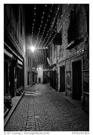black and white picture photo medieval street by night with