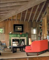 rustic market living room rustic with wood paneling stacked books