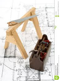 Construction House Plans by Construction Tools On House Plans Royalty Free Stock Photo