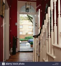 Painted Banisters Cream Painted Banisters On Staircase In Red Townhouse Hall With An