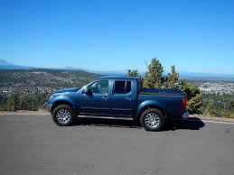 nissan frontier crew cab long bed black truck bed cover on blue nissan frontier a black diam u2026 flickr