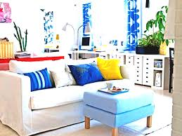 ikea bright colors chairs in modern home living room furniture white sofa blue cushions benchtable soft carpet wooden laminate flooring houseplant sideboard white wall paint decoration