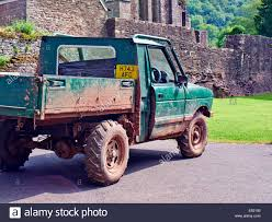 green land rover a 1990 dirty muddy green land rover rebel pick up truck covered in