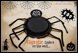 diy gigantic styrofoam plate spiders halloween party decor