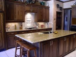 Granite Countertops With Cherry Cabinets Top Giallo Ornamental Granite With Cherry Cabinets 78 To Your Home